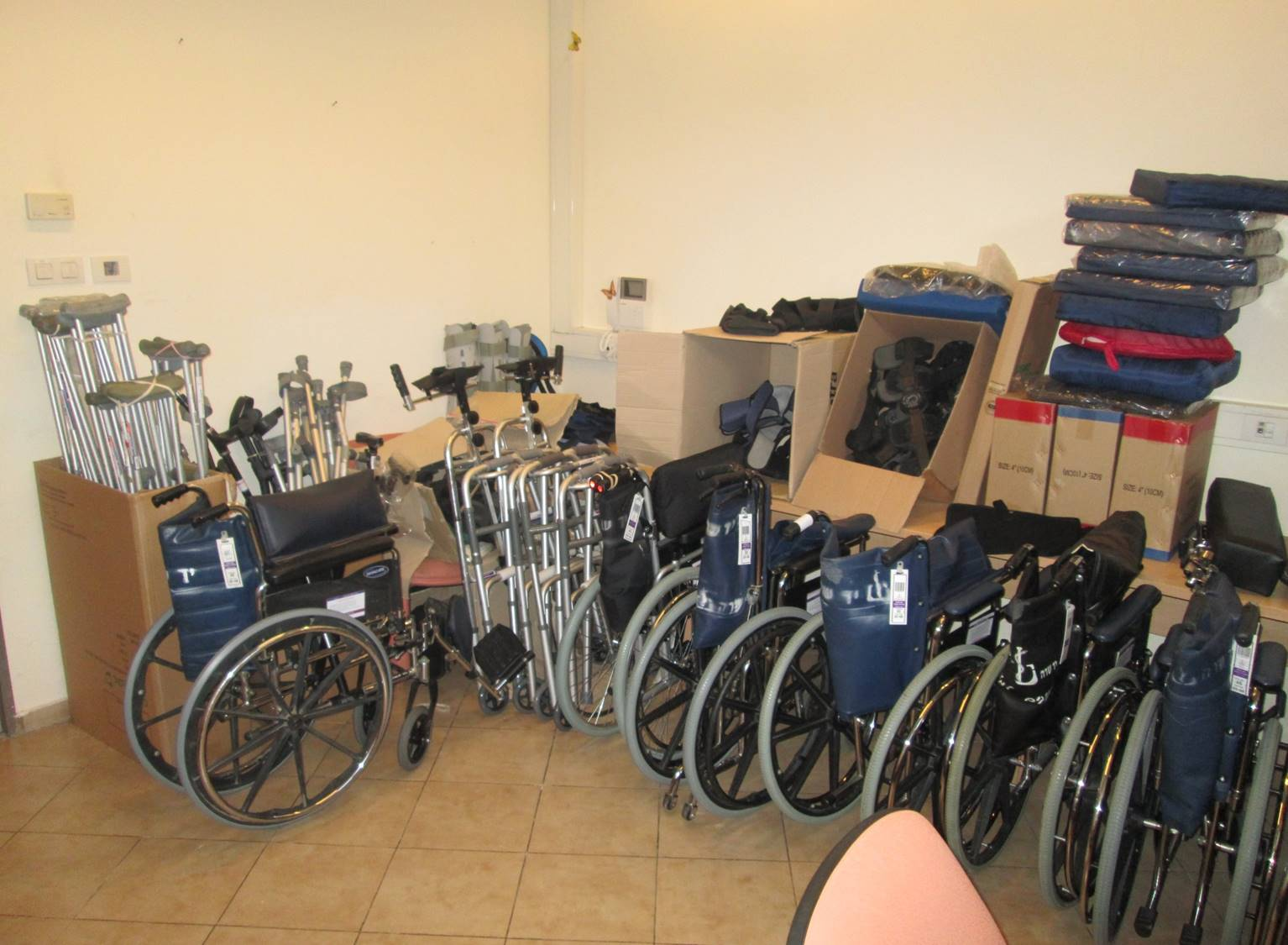 Warehouse with wheelchairs, crutches and other mobility devices