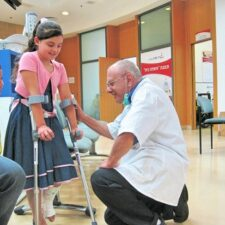Yad Sarah Volunteer fits young girl with crutches