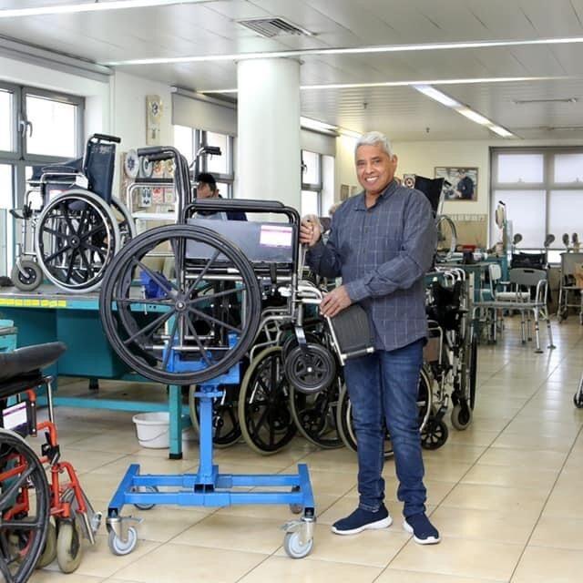 Volunteer Refurbishing Yad Sarah Wheelchair
