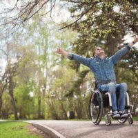 Young Man in Wheelchair_Feeling Happy