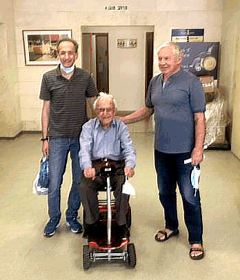 95 year-old Alexander Brenner, tries motorized scooter at Yad Sarah lending centre in Ra'anana, Israel